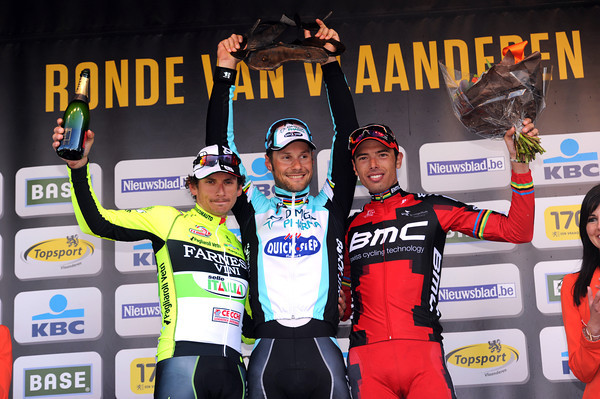 Tom Boonen is all smiles on the podium - not so, Pozzato and Ballan..!