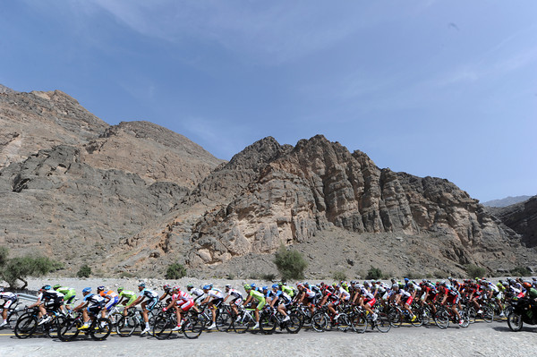 The peloton is speeding through a mighty canyon, already in earnest pursuit...