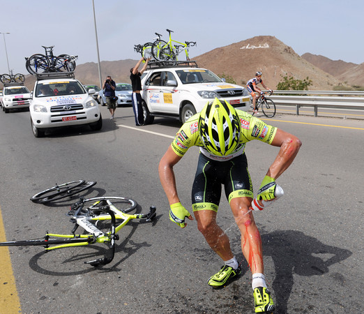 Luca Ascani was in the crash too - he's already squirting water over his knee wound...