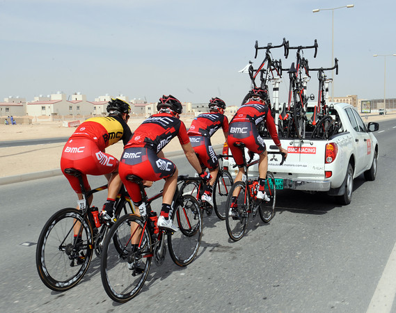 Philippe Gilbert and his BMC teamates are riding the 50-kilometres to the start behind their team-car - at 75-kilometres-per-hour..!