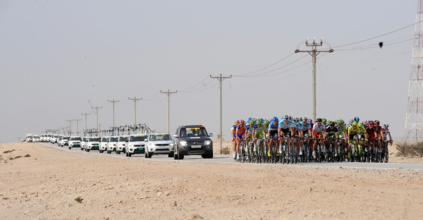 The long road across the Qatari desert reveals a paced peloton still four minutes down on the escape...
