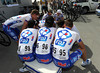 On such a windy stage FDJ's riders are huddled in a serious team-talk before the start...