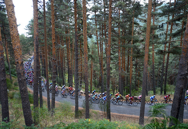 The peloton climbs the Navafria with the weather turning from sun and warmth to cloud, rain, and cold...