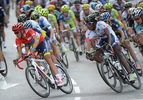 Two differing worlds - Vuelta winner Contador races just ahead of Daniel Teklehaimanot, soon to finish his first-ever Vuelta...