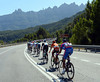 The rocky spires of Montserrat look down on a peloton going very, very fast...