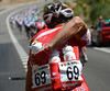 Nico Sijmens shows a good flex as he loads up with bottles for his Cofidis teamates...