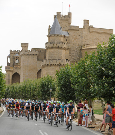 The peloton speeds past a castle somewhere in Navarra...