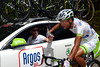 Cheng Ji, the only Chinese rider in the World Tour peloton, collects water bottles for his Argos teamates...