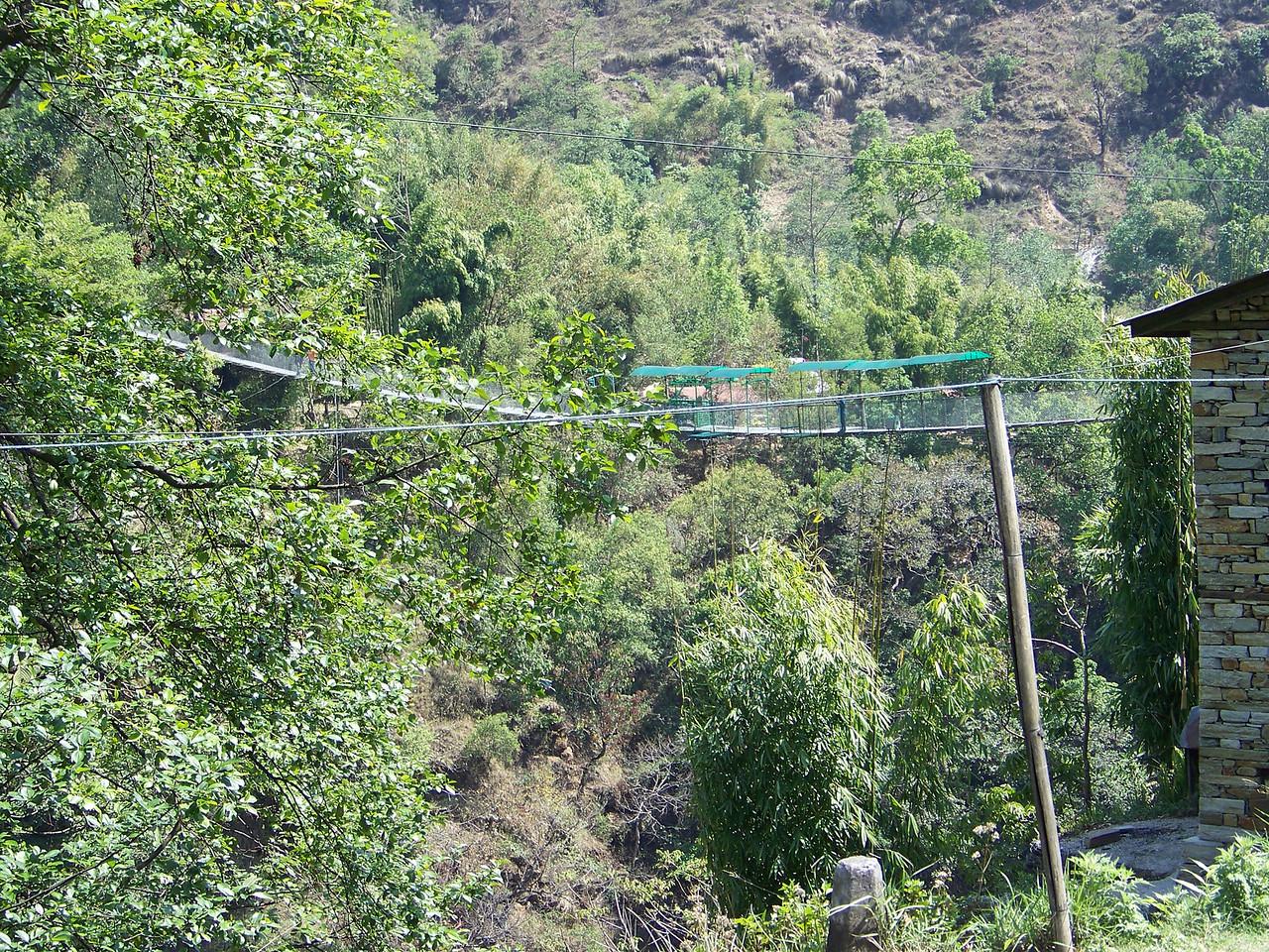 0646 - Locals Walking Bridge along Araniko Highway in Nepal Between Kodari and Katmandu - Nepal.JPG