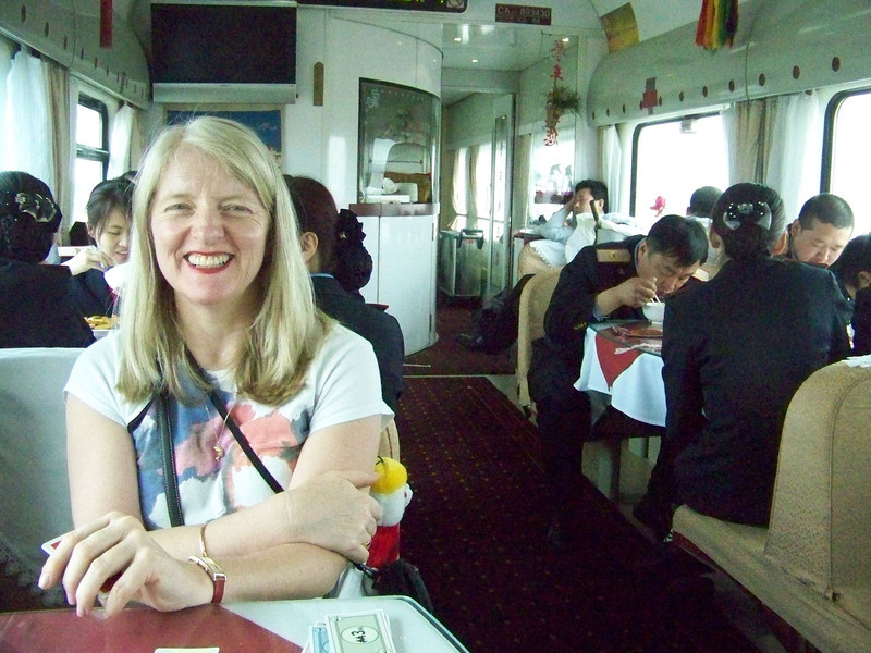 0083 - Sarah in Dining Car on Train Trip Between Beijing and Lhasa.JPG