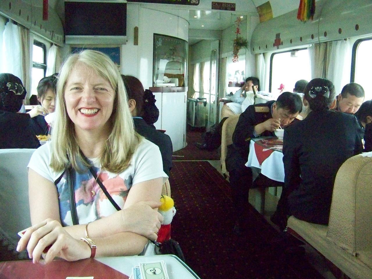 0083 - Sarah in Dining Car on Train Trip Between Beijing and Lhasa.JPG