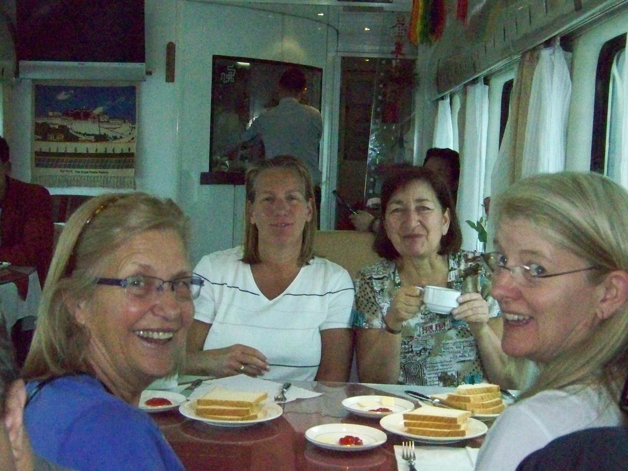 0098 - Sharon Lorie Beryl Sarah having Breakfast in Dining Car 2nd Morning on Train Trip Between Beijing and Lhasa.JPG