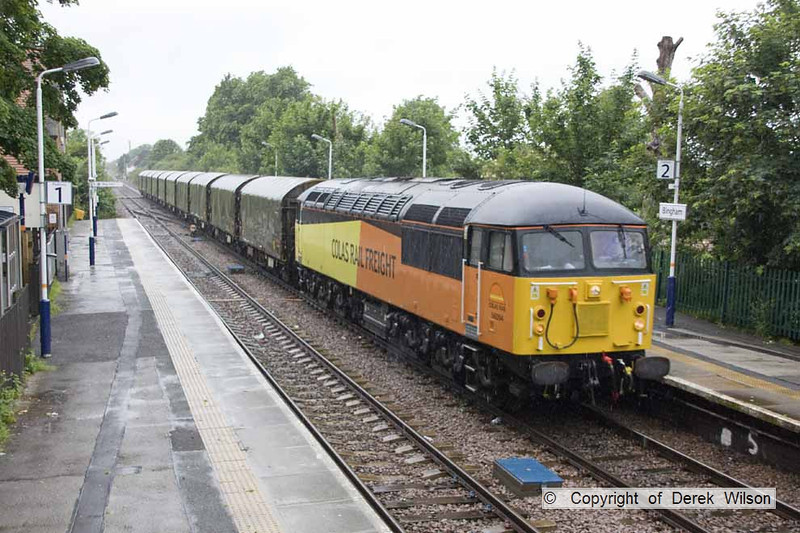120702-001     Colas Rail class 56 no. 56094 passes through a rainsoaked Bingham, powering train 6E07, 11.51 Washwood Heath - Boston docks, empty covered steel carrying wagons.
