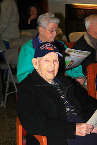 Retired Chief Ed Burrell, to sole surviving member of the Department who worked at the Stand Theatre Fire on March 10th,1941, and was assigned to Ladder Co. 2.