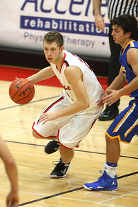 The Hinsdale Central High School boys' varsity basketball team defeats Sandburg 47-37 at the Hinsdale Central Thanksgiving Tournament, Nov. 26, 2013.  (Daniel White photos).