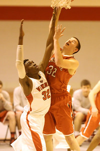 The Hinsdale Central High School boys' varsity basketball team defeats Homewood Flossmoor 58-55 in overtime at the Proviso West Tournament. (Daniel White photos).