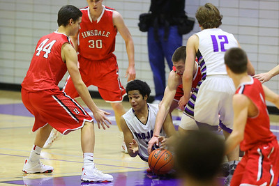 The Hinsdale Central High School boys' varsity basketball team plays Downers Grove North. (Daniel White photos).