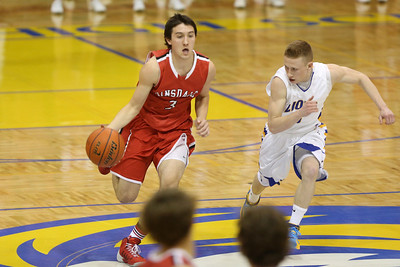 The Hinsdale Central High School boys' varsity basketball team defeats Lyons Township 63-57 in overtime Feb.15, 2014 at Western Springs. (Daniel White photos).