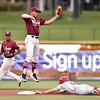 Frisco RoughRiders shortstop Luis Marte (15),Springfield Cardinals outfielder Thomas Spitz (5)