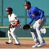 Frisco RoughRiders second baseman Andy Ibanez (24),Midland RockHounds first baseman Viosergy Rosa (34)