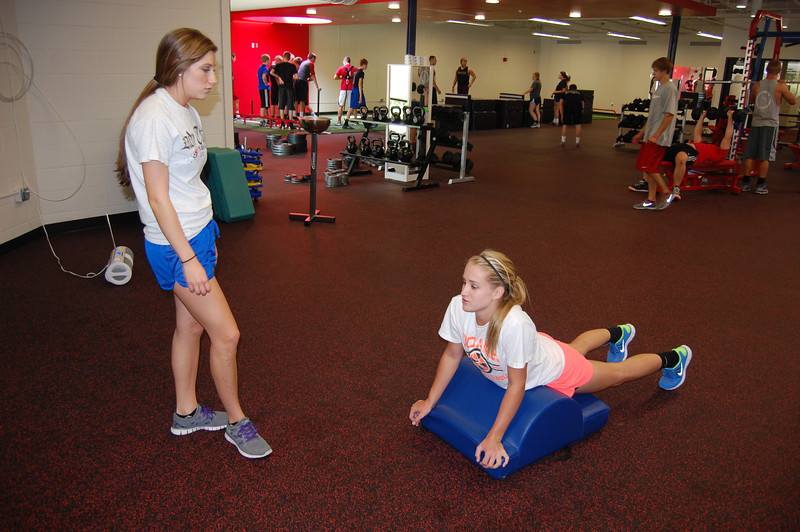 Michelle D and Hannah Evans stretching