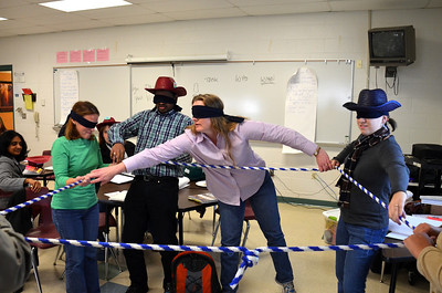 Making a square with a rope - while blindfolded - calls for strong communication skills, as new Team Managers are learning.