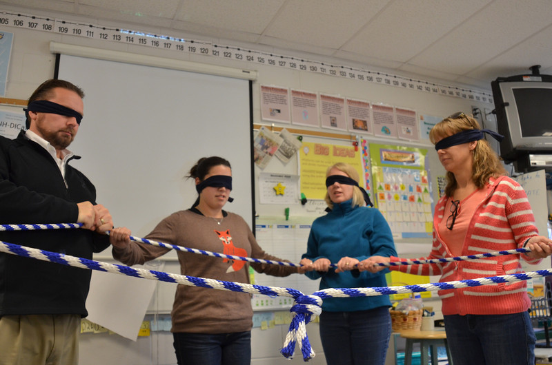Trying to make a square with the rope. Blindfolded.