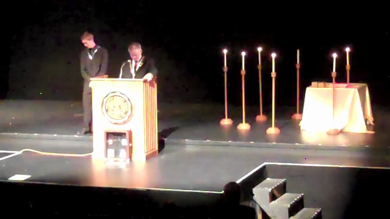 DeMolay Executive Officer Greg Chiles Introduces the Delegation Representing MWGM Mark A. Genung at the DeMolay Conclave at the Moore Theater at DePauw University in Greencastle. Those representing the Grand Masters were: Daniel J. Barenie, DGM, William A. Reiners, SGW, Randolph L. Seipel, Grand Marshal, and Carl E. Culmann, JGD