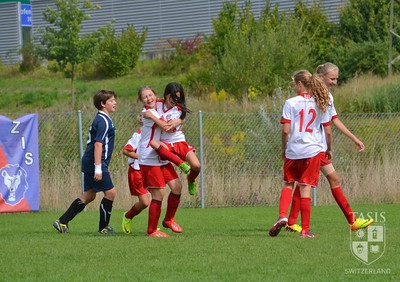 Middle School Girls Soccer team competes in their first team in Zurich.
