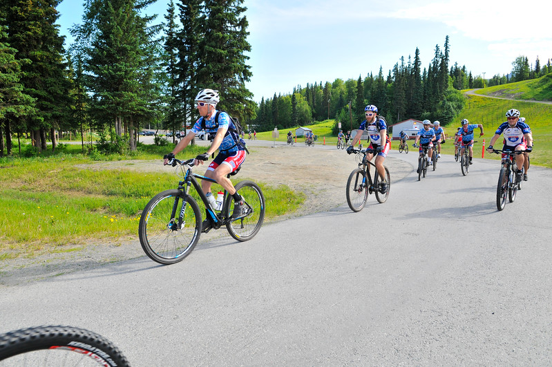 Riders bike the single track trails of Hillside Park in Anchorage during the first Ride 2 Recovery Alaska Adventure presented by The Tatitlek Corporation.  As a 501(c)(3) organization, R2R helps injured active duty service members and veterans improve their health and wellness through individual and group cycling.