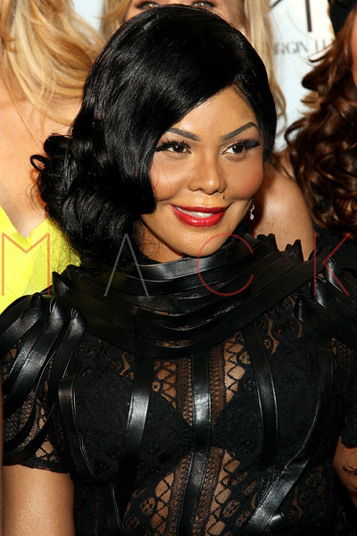 "NEW YORK, NY - FEBRUARY 09:  Lil' Kim attends the ""The Reality Of Fashion, The Reality Of AIDS"" Benefit - 2013 Mercedes-Benz Fashion Show at Altman Building on February 9, 2013 in New York City.  (Photo by Steve Mack/S.D. Mack Pictures)"