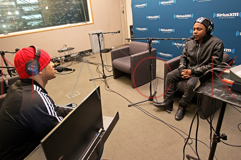 """NEW YORK, NY - JANUARY 24:  DJ Steel interviews Kendrick Lamar Live On Hip-Hop Nation's """"Thursday Night Live With DJ Envy And DJ Steel"""" at SiriusXM Studios on January 24, 2013 in New York City.  (Photo by Steve Mack/S.D. Mack Pictures)"""