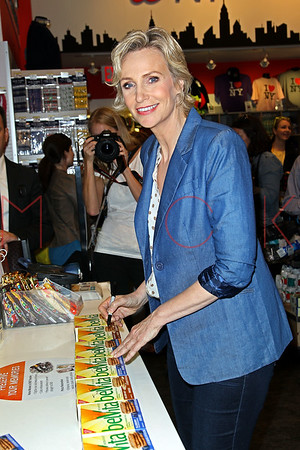 NEW YORK, NY - MAY 20:  Jane Lynch Hands Out BelVita Breakfast Biscuits To Morning Commuters in Times Square on May 20, 2013 in New York City.