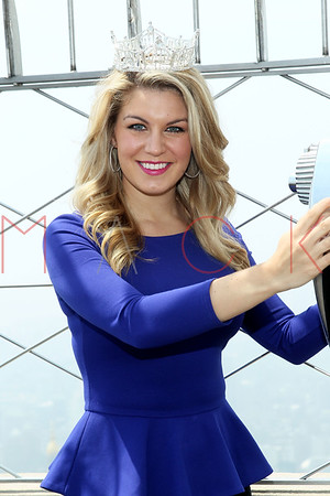NEW YORK, NY - MAY 29:  Miss America 2013 Mallory Hagan lights The Empire State Building on May 29, 2013 in New York City.