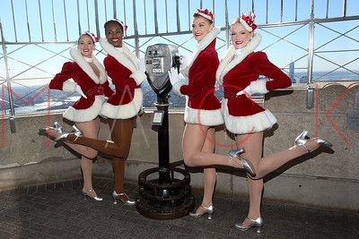 NEW YORK, NY - NOVEMBER 13:  The Rockettes light The Empire State Building on November 13, 2013 in New York City.