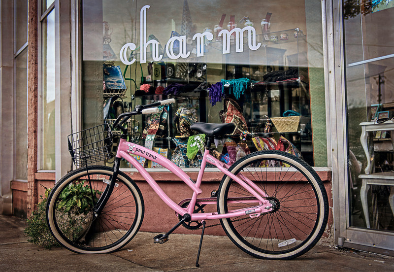 charm + a pink bicycle