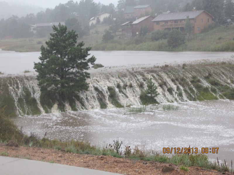 Courtesy of the Town of Estes Park. Water rushing over the banks of Scott Pond.