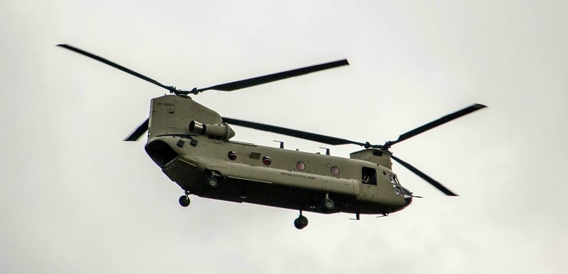 . A Chinook helicopter flies in to rescue stranded residents