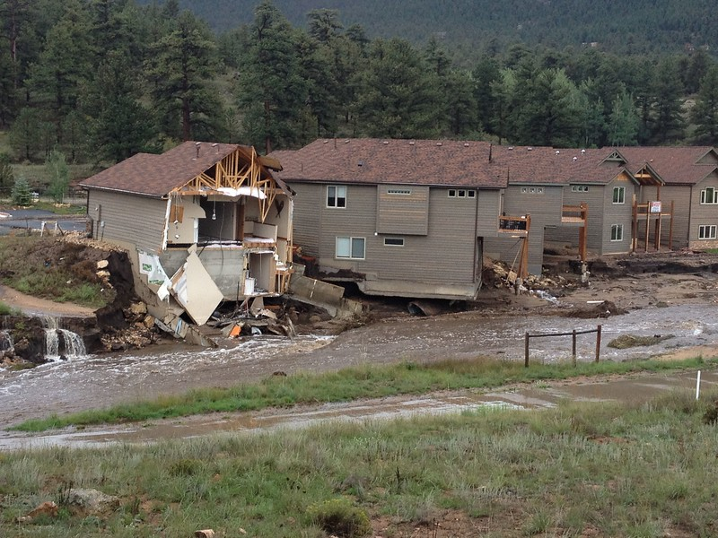 Courtesy of the Town of Estes Park. Water washed away the backside of homes along Fish Creek Road