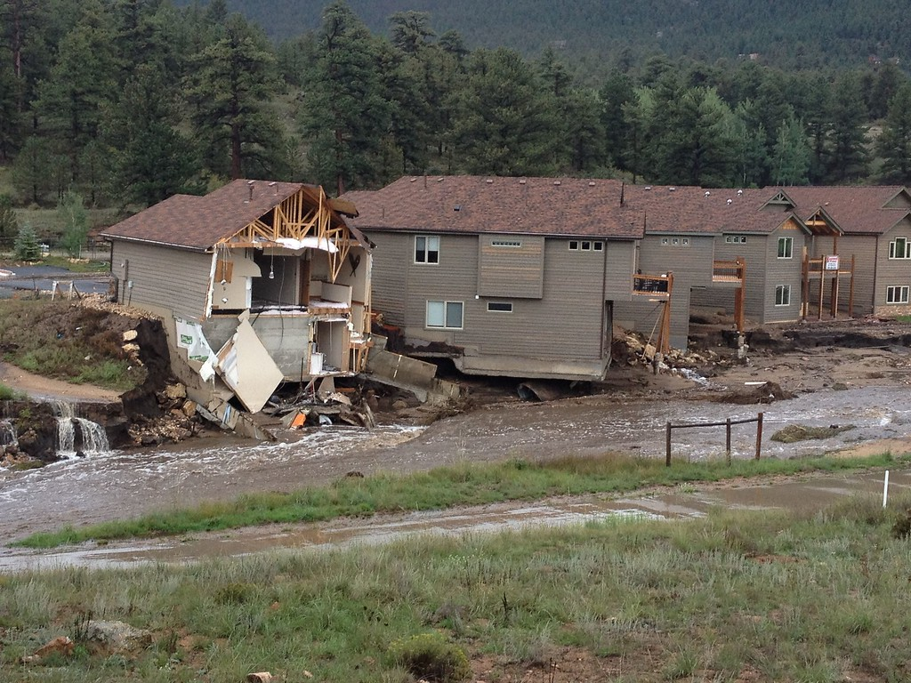 . Courtesy of the Town of Estes Park. Water washed away the backside of homes along Fish Creek Road