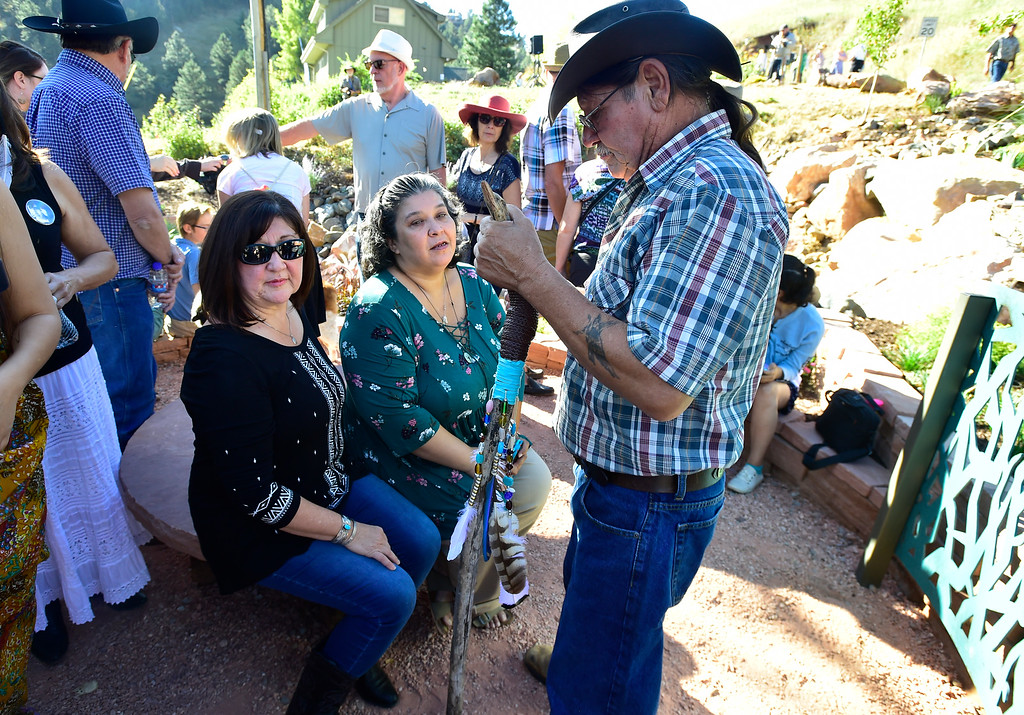 . BOULDER CO - SEPTEMBER 15 2018 Glenda Aretxuloeta, mother of Wesley Quinlan, left, and Jennifer Nelson mother of Wiyanna Nelson take in the area during the dedication of the Community Memorial Garden at the intersection of Linden Drive and South Cedar Brook Road in Boulder on Saturday in remembrance of the 2013 Colorado Front Range Flood. Wesley Quinlan and Wiyanna Nelson were driving in the area late Sept. 11, 2013 when their car was trapped in a mudslide and they left the vehicle and were swept away. With the two is Wesley\'s uncle Steven Gurule.   For more photos go to dailycamera.com (Photo by Paul Aiken/Staff Photographer)
