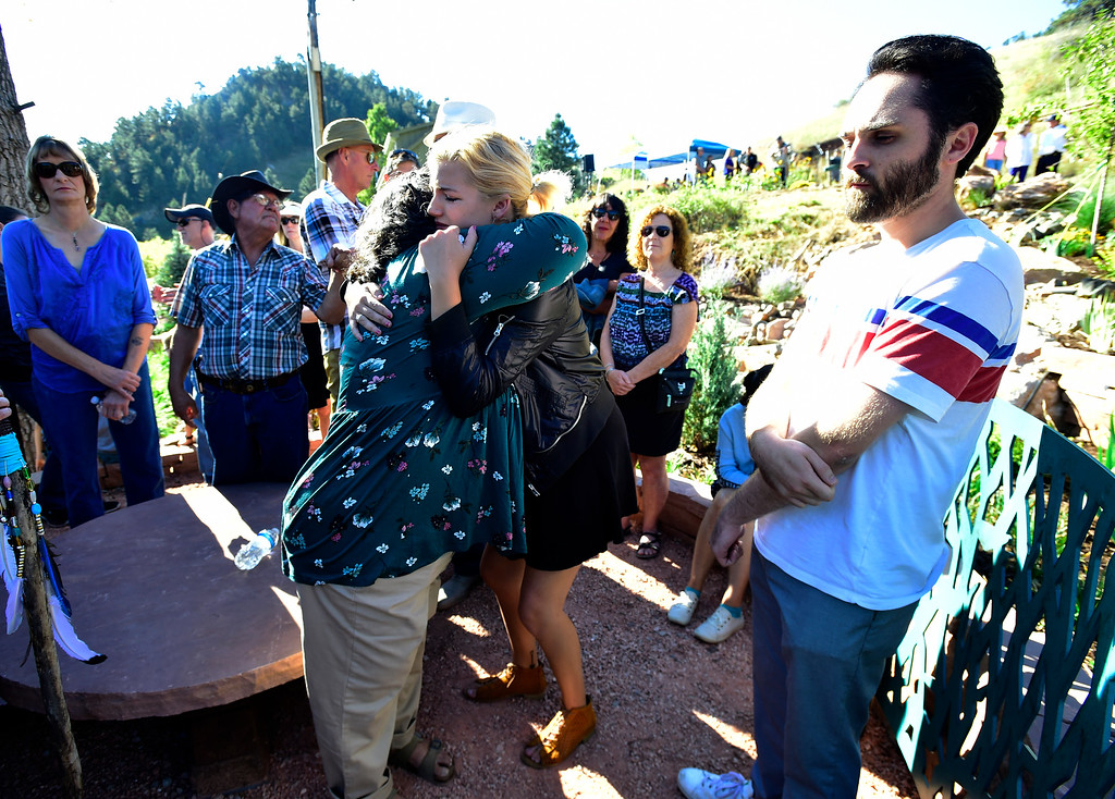 . BOULDER CO - SEPTEMBER 15 2018 Jennifer Nelson hugs Emily Briggs after the dedication of the Community Memorial Garden at the intersection of Linden Drive and South Cedar Brook Road in Boulder on Saturday in remembrance of the 2013 Colorado Front Range Flood. Nelson\'s daughter Wiyanna and Wesley Quinlan were killed at this intersection when the car they were in was trapped in a mudslide at that location on September 11, 2013. Briggs was in the car but survived by staying in the vehicle. At right were Quinlan and Nelson\'s friend Brian Boucher. For more photos go to dailycamera.com (Photo by Paul Aiken/Staff Photographer)