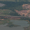 Interstate 44 bridge across the Canadian River West of Moore OK.  This is 5 miles South of the OKC Airport.  There is an old metal bridge on the near side of the interstate bridge, the tornado took out most of the spans left of the river.  A demolition crew has a lot of the steel removed.