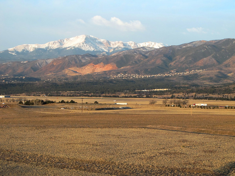 The view from our hotel room.  Residence Inn, Air force Academy, Colorado Springs.  The two trucks are on I-25.  That's Pikes Peak in the background.  A plane is on the runway of the Air Force Acadamy Airport, center of the picture.