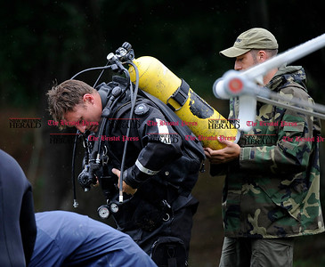 8/1/2013 Mike Orazzi | Staff  Members of the Connecticut State Police dive team search Pine Lake on Pine Street in Bristol Thursday while looking for evidence in the murder of Odin Lloyd and the arrest of Aaron Hernandez on murder charges.