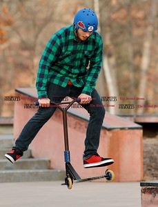 Kevin Bartram | Staff Dylan Duplessis gets some air while riding with friends at Rockwell Park in Bristol on Monday.