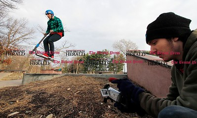 Kevin Bartram | Staff Dylan Duplessis clears a gap while Ben Edgerly shoots video at Rockwell Park in Bristol on Monday.