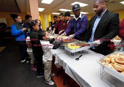 Kevin Bartram | Staff Eduardo Hinojosa, 7, leads the line at a free dinner for participants in the New Britain Police Activity League on Tuesday at the Senior Center. The event was organized by Timothy Conaway and his cousin Torrence Conaway.