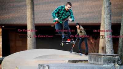 Kevin Bartram | Staff Dylan Duplessis gets some air while riding with Ben Edgerly at Rockwell Park in Bristol on Monday.