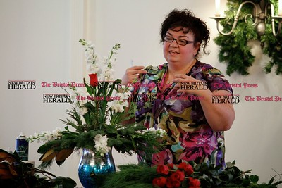 Kevin Bartram | Staff Floral designer Tina Calcagni of Berlin gives a demonstration during the Bristol Garden Club's annual holiday luncheon on Monday at the Farmington Club in Farmington.